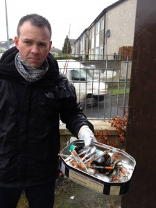 Cllr John Brady after clearing out a derelict council house.