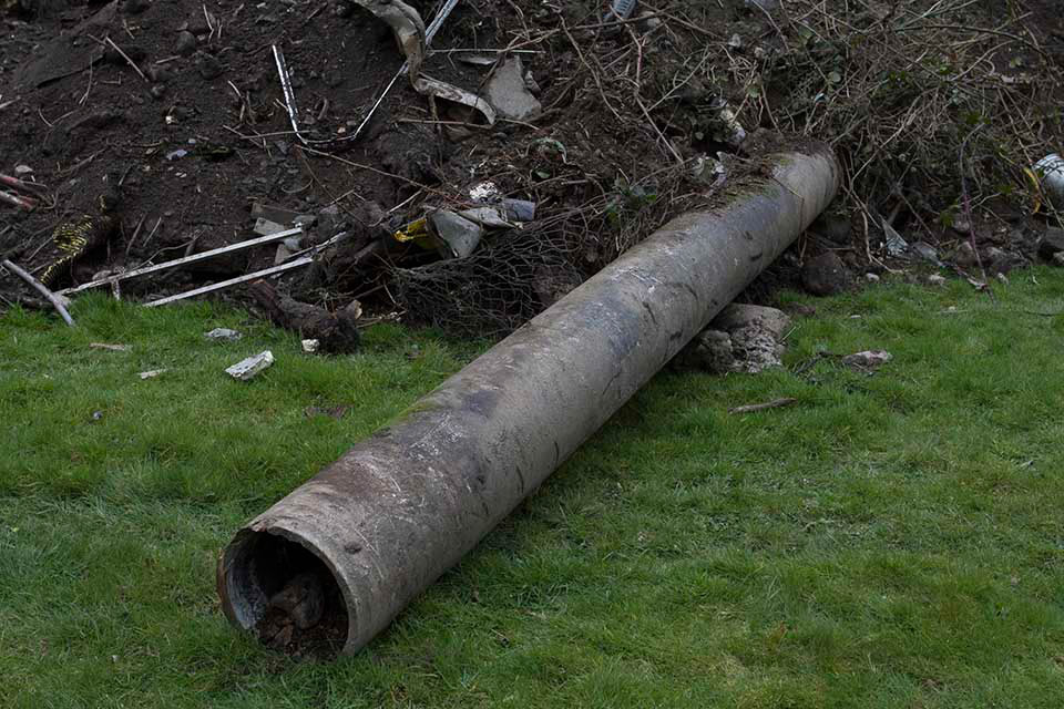 The large asbestos pipe.
