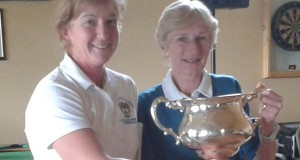 Suzanne Hegarty (lady captain) presents the Maureen Doyle memorial trophy to the winner Dympna Darby(right)