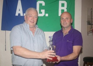 James Furlong presenting Mick Healy with AGB Ladies Club Person of the Year