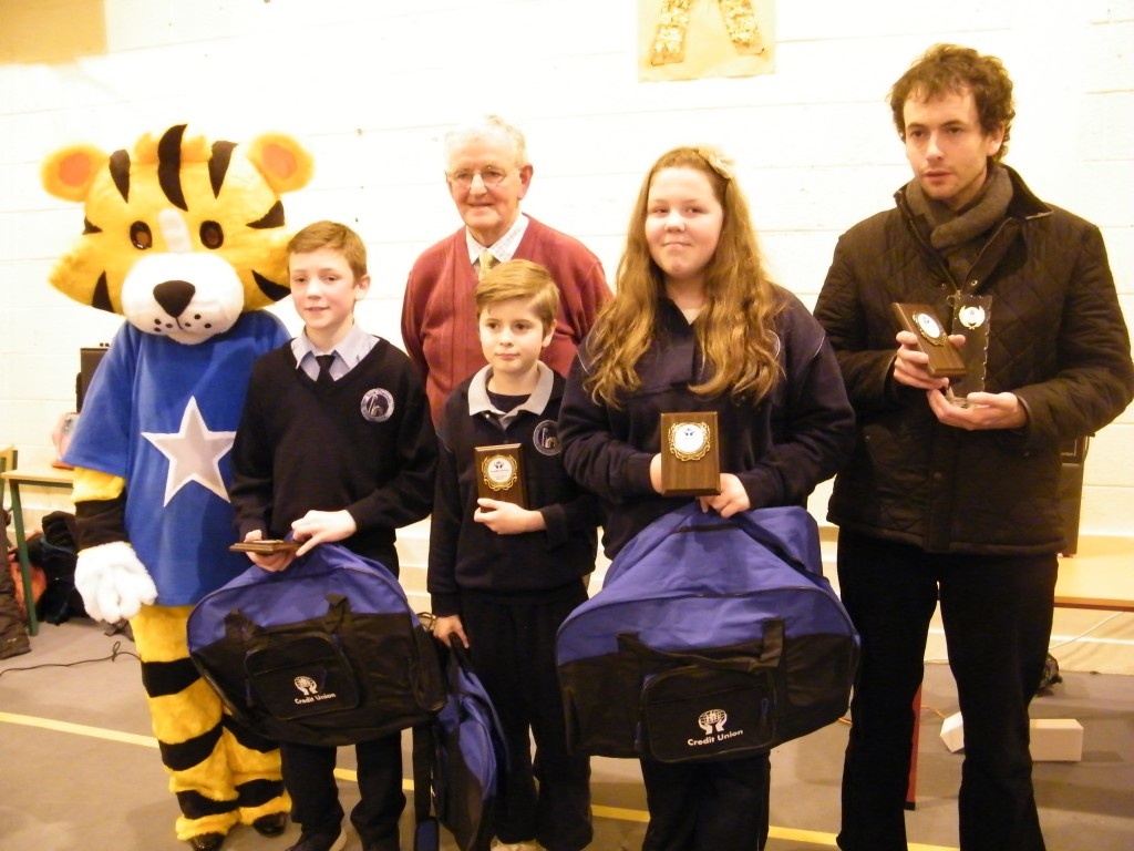 Winners of 1st place at competition B under 13's  Scoil Diarmada N.S. Castledermot -- Sean Casserley, Oisin Nolan, Rachel O'Learly, with teacher Barry Whelan, Owen Cooney Credit Union and our mascot Mr Jungles