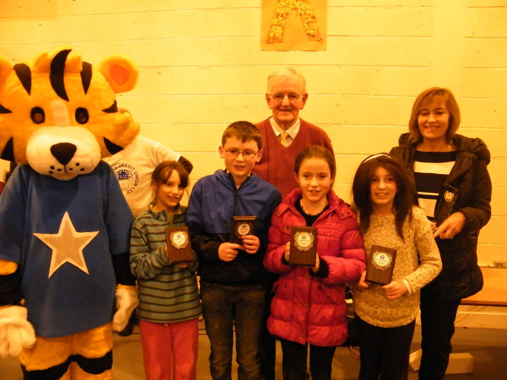 winners of 1st place at competition A under 11's Rathcoyle N.S. Rathdangan -- Amber O'Farrell, Roisin Byrne, Radha Rynhart, Tom Parker with teacher Triona Byrne, Owen cooney credit union and our mascot Mr Jungles