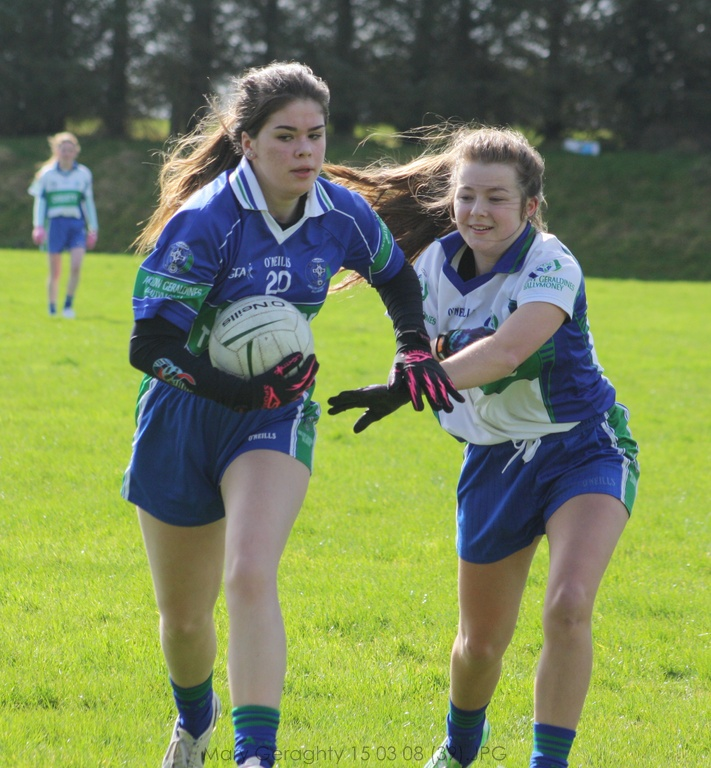 Emma Ryan and Medbh O'Connor contest for the ball.