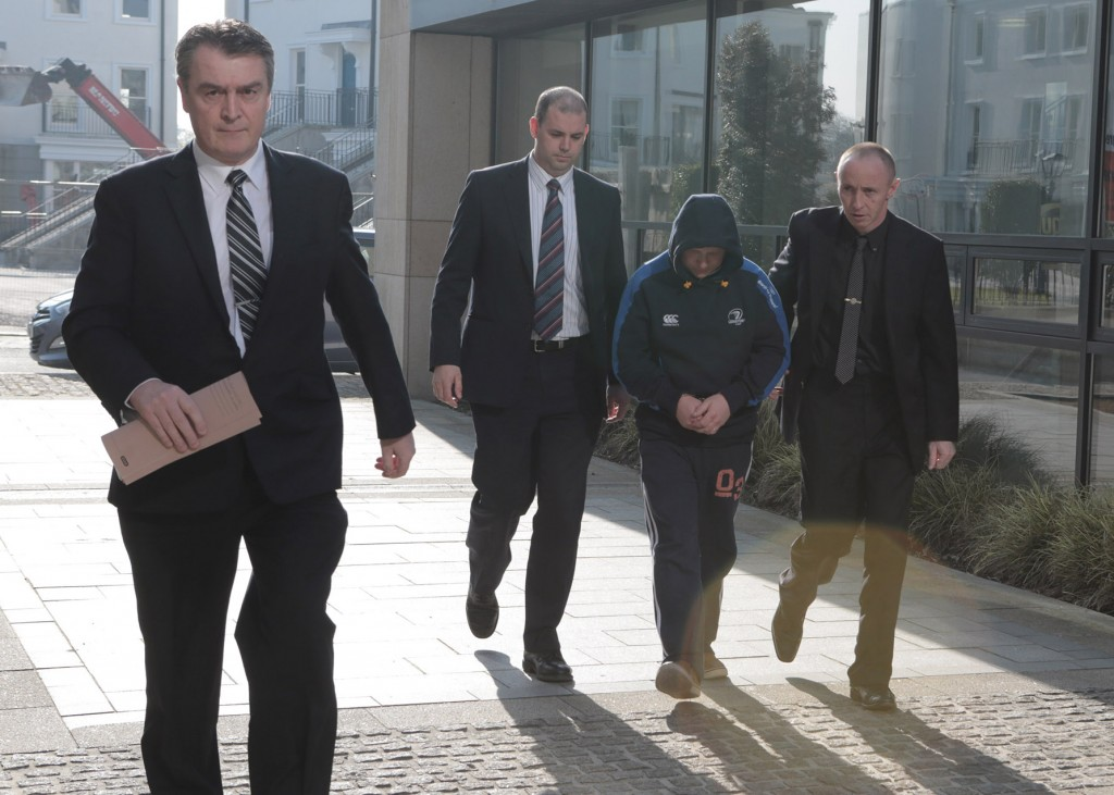 Charged: Roy Webster is led into Bray court by detectives