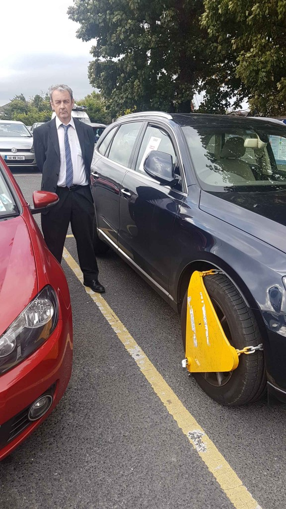 cllr-michael-oconnor-in-the-herbert-road-carpark-at-a-clamped-car